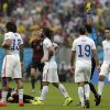 United States\' Kyle Beckerman, center, is booked by referee Ravshan Irmatov from Uzbekistan after fouling Germany\'s Bastian Schweinsteiger, bottom left, during the group G World Cup soccer match between the USA and Germany at the Arena Pernambuco in Recife, Brazil, Thursday, June 26, 2014. (AP Photo/Petr David Josek)