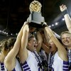 Okarche\'s Kenadey Grellner, center left, Chelsea Mueggenborg, and Randi Hufnagel, at right, celebrate with the trophy after winning the Class A girls state championship game between Okarche and Cheyenne/Reydon in the State Fair Arena at State Fair Park in Oklahoma City, Saturday, March 2, 2013. Photo by Bryan Terry, The Oklahoman