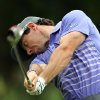 Photo - Rory McIlroy, of Northern Ireland, hits his tee shot on the fifth hole during second round play at The Barclays golf tournament Friday, Aug. 22, 2014, in Paramus, N.J. (AP Photo/Adam Hunger)