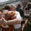 Texas coach Mack brown hugs UT\'s Mason Walters (72) after the Red River Rivalry college football game between the University of Oklahoma Sooners and the University of Texas Longhorns at the Cotton Bowl Stadium in Dallas, Saturday, Oct. 12, 2013. Texas won 36-20. Photo by Bryan Terry, The Oklahoman