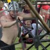 David James Butler puts his back into the human powered carosel during Medieval Fair on Friday, March 30, 2012, in Norman, Okla. Photo by Steve Sisney, The Oklahoman