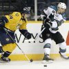 San Jose Sharks right wing Ryane Clowe (29) passes the puck as Nashville Predators defenseman Roman Josi (59), of Switzerland, closes in during the first period of an NHL hockey game Tuesday, Feb. 12, 2013, in Nashville, Tenn. (AP Photo/Mark Humphrey)