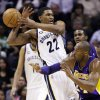 Los Angeles Lakers\' Kobe Bryant, right, knocks the ball away form Memphis Grizzlies\' Rudy Gay (22) during the first half of an NBA basketball game in Memphis, Tenn., Wednesday, Jan. 23, 2013. (AP Photo/Daniel Johnston)