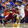 Alabama\'s Daisha Simmons (0) drives against Tennessee\'s Kamiko Williams (4) in the first half of an NCAA college basketball game on Sunday, Jan. 20, 2013, in Knoxville, Tenn. (AP Photo/Wade Payne)