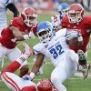 Photo - Indiana State running back LeMonte Booker (32) is tackled by Indiana safety Chase Dutra (30) during an NCAA college football game at Memorial Stadium in Bloomington, Ind., Saturday, Aug. 30, 2014. (AP Photo/The Herald-Times, Chris Howell)