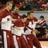 From left, OU players Casey Arent, James Fraschilla, D.J. Bennett and C.J. Cole play air guitar from the bench after the Sooners hit a 3-point shot during an NCAA men\'s basketball game between the University of Oklahoma (OU) and Texas Christian University (TCU) at the Lloyd Noble Center in Norman, Okla., Monday, Feb. 11, 2013. Photo by Nate Billings, The Oklahoman