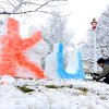 University of Kansas alum Geoff Folker applies food coloring to his snow sculpture at his home on Park Street in Olathe, Kan., on Sunday, March 24, 2013. A storm that dumped up to 15 inches of snow on parts of Colorado and Kansas is making its way east, with winter storm warnings and advisories issued for today and tomorrow as far east as Pennsylvania. (AP Photo/The Kansas City Star, John Sleezer)