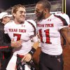 Texas Tech\'s Seth Doege (7) and Tramain Swindall (11) celebrate after defeating Oklahoma 41-38 during the college football game between the University of Oklahoma Sooners (OU) and Texas Tech University Red Raiders (TTU) at the Gaylord Family-Oklahoma Memorial Stadium on Sunday, Oct. 23, 2011. in Norman, Okla. Photo by Chris Landsberger, The Oklahoman
