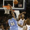 Kevin Durant blocks a shot by Nene in the first half as the Oklahoma City Thunder play the Denver Nuggets at the Ford Center in Oklahoma City, Okla. on Friday, January 2, 2009. Photo by Steve Sisney/The Oklahoman