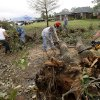 People clear fallen trees in the Dripping Springs Estates Saturday, May 15, 2010. Saturday hundreds of volunteers went into areas that had been affected by last week\'s tornadoes to help clear debris. Photo by Doug Hoke, The Oklahoman.