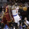 New York Knicks\' Raymond Felton (2) drives past Cleveland Cavaliers\' Luol Deng, (9) during the first quarter of an NBA basketball game Saturday, March 8, 2014, in Cleveland. (AP Photo/Tony Dejak)