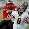 Midwest City\'s Joel Davis runs past Del City\'s Steffon Herd during a high school football game in Del City, Okla., Friday, September 2, 2011. Photo by Bryan Terry, The Oklahoman