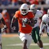 Oklahoma State\'s Joseph Randle (1) out runs Baylor\'s Earl Patin and Chris Francis (36) during the college football game between the Oklahoma State University Cowboys (OSU) and the Baylor University Bears at Boone Pickens Stadium in Stillwater, Okla., Saturday, Nov. 6, 2010. Photo by Chris Landsberger, The Oklahoman
