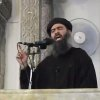This image made from video posted on a militant website Saturday, July 5, 2014, which has been authenticated based on its contents and other AP reporting, purports to show the leader of the Islamic State group, Abu Bakr al-Baghdadi, delivering a sermon at a mosque in Iraq. A video posted online Saturday purports to show the leader of the Islamic State extremist group that has overrun much of Syria and Iraq delivering a sermon at a mosque in Iraq, in what would be a rare - if not the first - public appearance by the shadowy militant. (AP Photo/Militant video)