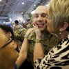 1st Lt. Brett Campbell gets a kiss from his mother, Jo Campbell, right, as Kelly Krouse, his aunt, places her hand on his shoulder at the end of a homecoming ceremony for members of the Oklahoma National Guard\'s 45th Infantry Brigade Combat Team returning from Afghanistan at the Will Rogers Air National Guard Base in Oklahoma City, Friday, March 30, 2012. Photo by Nate Billings, The Oklahoman