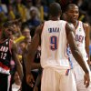 Oklahoma City\'s Kevin Durant (35) and Serge Ibaka (9) celebrate their win in front of Portland \'s LaMarcus Aldridge (12) during the NBA basketball game between the Oklahoma City Thunder and the Portland Trail Blazers at Chesapeake Energy Arena in Oklahoma City, Sunday, March 18, 2012. Photo by Sarah Phipps, The Oklahoman.