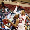 Photo - Mustang's Terrell Williams (10) moves to the hoop in front of Del City's Stephen Edwards (12) during a high school basketball between Del City and Mustang at Del City High School in Del City, Okla., Thursday, Dec. 27, 2012.  Photo by Nate Billings, The Oklahoman