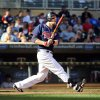 Photo -   Minnesota Twins' Justin Morneau watches his walkoff home run against the Cleveland Indians in the ninth inning of a baseball game in Minneapolis, Sunday, Sept. 9, 2012. The Twins won 8-7. (AP Photo/Craig Lassig)