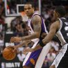 Photo -   Phoenix Suns' Shannon Brown, left, looks to pass as San Antonio Spurs Derrick Byars defends during the second half of an NBA basketball game, Wednesday, April 25, 2012, in Phoenix. (AP Photo/Matt York)