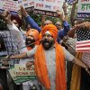 Photo -   Indian Sikhs holding swords shout slogans during a protest in New Delhi, India , Monday, Aug. 6, 2012 against Sunday's killing of 6 people at the Sikh temple in the United States. Indian Prime Minister Manmohan Singh said Monday that he was shocked and saddened by the shooting attack that killed six people at a Sikh house of worship in the U.S. state of Wisconsin. (AP Photo/ Manish Swarup)