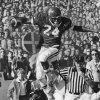 OU FOOTBALL: Joe Washington jumps over another player during OU\'s game against Kansas. 11-9-75