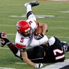 Mustang\'s Colton Hadlock leaps over Yukon\'s Matt Cammons during a high school football game in Yukon, Okla., Friday, August 31, 2012. Photo by Bryan Terry, The Oklahoman