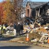 Utility workers, and investigators stand outside destroyed homes on Fieldfare Way in the Richmond Hills subdivision Monday, Nov. 12, 2012. An explosion, originating on Fieldfare Way, destroyed or damaged as many as 80 structures in the subdivision late Saturday night November 10, 2012. (AP Photo/The Indianapolis Star, Joe Vitti)