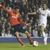 Photo - Benfica's Rodrigo, left, scores a goal past Tottenham's Kyle Naughton, right, during the Europa League round of 16 first leg soccer match between Tottenham Hotspur and SL Benfica at White Hart Lane stadium in London Thursday, March 13, 2014. (AP Photo/Kirsty Wigglesworth)