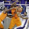 Oklahoma State\'s Marcus Smart (33) and Kamari Murphy (21) combine to steal the ball away from TCU \'s Connell Crossland, right, in the first half of an NCAA college basketball game on Wednesday, Feb. 27, 2013, in Fort Worth, Texas. (AP Photo/Tony Gutierrez) ORG XMIT: TXTG103
