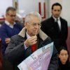 Outgoing Premier Mario Monti holds ballots prior to voting, in Milan, Italy, Sunday, Feb. 24, 2013. Italy votes in a watershed parliamentary election Sunday and Monday that could shape the future of one of Europe\'s biggest economies. (AP Photo/Luca Bruno)