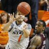 OSU\'s Cezar Guerrero (1) passes the ball away from Texas A&M\'s David Loubeau (10) in the second half of a men\'s college basketball game between the Oklahoma State University Cowboys and Texas A&M University Aggies at Gallagher-Iba Arena in Stillwater, Okla., Saturday, Feb. 25, 2012. OSU won, 60-42. Photo by Nate Billings, The Oklahoman