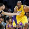 Los Angeles Lakers\' Kobe Bryant, right, and Brooklyn Nets\' Deron Williams go after a loose ball in the first half of an NBA basketball game in Los Angeles, Tuesday, Nov. 20, 2012. (AP Photo/Jae C. Hong)