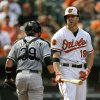 Photo - Baltimore Orioles' Chris Davis, right, reacts after striking out swinging to end the third inning of a baseball game against the Chicago White Sox, Sunday, Sept. 8, 2013, in Baltimore. (AP Photo/Patrick Semansky)