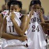 Northeast\'s Danielle Gaddis (11) and Jaelyn Coleman (24) wipe the tears after the loss to Fairview during the 2A girls State Basketball Championship game between Northeast High School and Fairview High School at State Fair Arena on Saturday, March 10, 2012 in Oklahoma City, Okla. Photo by Chris Landsberger, The Oklahoman