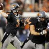 Oklahoma State\'s Brandon Weeden (3) passes the ball during a college football game between the Oklahoma State University Cowboys (OSU) and the Kansas State University Wildcats (KSU) at Boone Pickens Stadium in Stillwater, Okla., Saturday, Nov. 5, 2011. Photo by Nate Billings, The Oklahoman