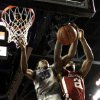 Photo - Kansas State's Wesley Iwundu (25) and Oklahoma's Cameron Clark (21) go up for a rebound during the first half of an NCAA college basketball game Tuesday, Jan. 14, 2014, in Manhattan, Kan. (AP Photo/Charlie Riedel)