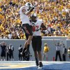 Oklahoma State\'s Marcell Ateman (3) and Oklahoma State\'s Tracy Moore (87) celebrate a touchdown during a college football game between the Oklahoma State University and West Virginia University on Mountaineer Field at Milan Puskar Stadium in Morgantown, W. Va., Saturday, Sept. 28, 2013. Photo by Sarah Phipps, The Oklahoman