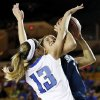 Photo - Deer Creek's Whitney Jones (13) fouls Shawnee's Bailey Taylor (20) during the Class 5A girls championship high school basketball game in the state tournament at the Mabee Center in Tulsa, Okla., Saturday, March 9, 2013. Photo by Nate Billings, The Oklahoman
