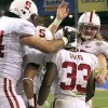 Stanford\'s Stepfan Taylor (33) celebrates his touchdown against Oklahoma State with teammates, including, Ryan Hewitt, right, during the first half of the Fiesta Bowl NCAA college football game Monday, Jan. 2, 2012, in Glendale, Ariz.(AP Photo/Ross D. Franklin)