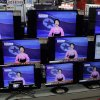 Photo - A man watches TV screen showing a North Korean TV anchorwoman announcing the success of a rocket launch, at an electronic shop in Seoul, South Korea, Wednesday, Dec. 12, 2012. North Korea successfully fired a long-range rocket on Wednesday, defying international warnings as the regime of Kim Jong Un took a giant step forward in its quest to develop the technology to deliver a nuclear warhead. (AP Photo/Lee Jin-man) ORG XMIT: LJM103