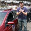 Photo - Actor Chris Pratt waits to drive the pace car for the Brickyard 400 auto race at Indianapolis Motor Speedway in Indianapolis, Sunday, July 27, 2014. (AP Photo/R Brent Smith)