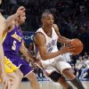 L.A. LAKERS: Oklahoma City\'s Russell Westbrook (0) tries to drive past the Lakers\'s Jordan Farmar (5) during the NBA basketball game between the Oklahoma City Thunder and the Los Angeles Lakers at the Ford Center, Tuesday, March 24, 2009, in Oklahoma City. PHOTO BY BRENDA O\'BRIAN, THE OKLAHOMAN ORG XMIT: KOD