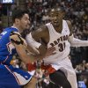 Photo - Toronto Raptors' Terrence Ross, (31) drives past Los Angeles Clippers' J.J. Redick during the second half of an NBA basketball game, Saturday, Jan. 25, 2014 in Toronto. (AP Photo/The Canadian Press, Chris Young)