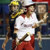 OU\'s Brianna Turang (2) reacts in front of Michigan catcher Lauren Sweet (25) after scoring in the third inning during an NCAA softball game in the Women\'s College World Series between Oklahoma and Michigan at ASA Hall of Fame Stadium, Thursday, May 30, 2013. Photo by Nate Billings, The Oklahoman