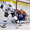 Los Angeles Kings\' Dustin Penner (25) deflects the puck as Edmonton Oilers goalie Nikolai Khabibulin (35) makes the save during the first period of their NHL hockey game, Tuesday, Feb. 19, 2013, in Edmonton, Alberta. (AP Photo/The Canadian Press, Jason Franson)