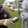 Photo - FILE - In this May 10, 2012 file photo, Mark Delbeck, of Burlington Electric, checks the radio frequency of a newly-installed