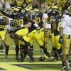 Photo - Michigan quarterback Devin Gardner (98) celebrates his touchdown during the second quarter of an NCAA college football game against Notre Dame in Ann Arbor, Mich., Saturday, Sept. 7, 2013. (AP Photo/Carlos Osorio)