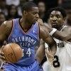 San Antonio Spurs guard Roger Mason, Jr., right, defends against Oklahoma City Thunder guard Desmond Mason during the first half of an NBA basketball game, Sunday, Dec. 14, 2008, in San Antonio. San Antonio won 109-104. (AP Photo/Darren Abate) ORG XMIT: TXDA110