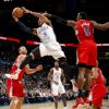 L.A. CLIPPERS: Oklahoma City\'s Russell Westbrook (0) goes to the basket between Los Angeles\' Blake Griffin (32) and DeAndre Jordan (9) during the NBA basketball game between the Oklahoma City Thunder and the Los Angeles Clippers at the Oklahoma CIty Arena, Tuesday, Feb. 22, 2011. Photo by Bryan Terry, The Oklahoman ORG XMIT: KOD