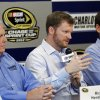 Dale Earnhardt Jr, center, talks about missing the next two races with his second concussion in the past six weeks as team owner Rick Hendrick, left, and crew chief Steve Letarte, right, look on during a news conference prior to practice for Saturday\'s NASCAR Bank of America 500 NASCAR Sprint Cup series auto race in Concord, N.C., Thursday, Oct. 11, 2012. (AP Photo/Terry Renna)